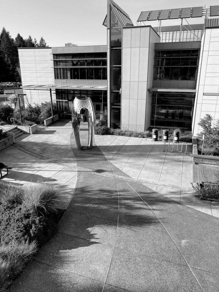 Silver sculpture amidst courtyard